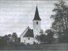 Guzajeva rojstna hiša ob cerkvi Sv. Primoža
