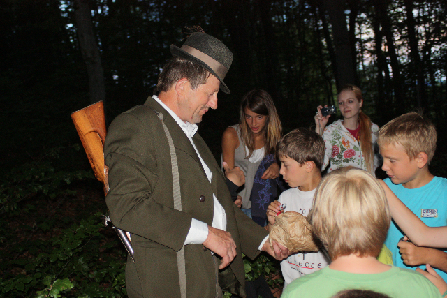 Children find Guzaj in the forest at dusk