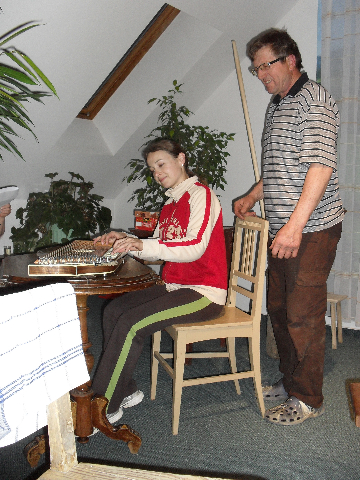 Guzaj woos Barbka as she plays the zither